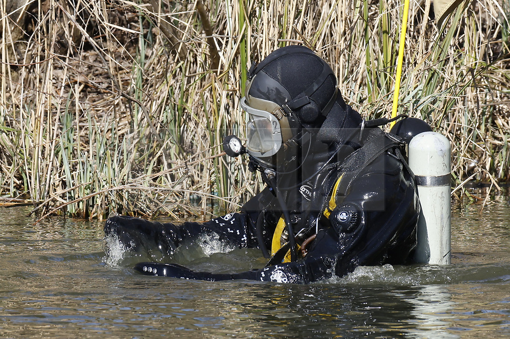 © Licensed to London News Pictures. 09/03/2021. London, UK. Police divers search a pond on Clapham Common as officers continue to look for missing 33 year old woman Sarah Everard. Police are concerned for the safety of Ms Everard who has been missing for six days after leaving a friend's house in Leathwaite Road, Clapham, London. She is thought to have walked across Clapham Common, and was due to arrive home in Brixton 50 minutes later. Photo credit: Peter Macdiarmid/LNP