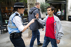 """© Licensed to London News Pictures . 24/06/2017. London, UK. Police separate some EDL supporters from anti fascists , on Northumberland Avenue . The English Defence League ( EDL ) hold a March on Parliament , from Charing Cross to Victoria Embankment , opposed by  a counter demonstration by Unite Against Fascism . Scotland Yard said it was using public order laws to restrict the marches """"due to concerns of serious public disorder, and disruption to the community"""" following terrorist attacks in Manchester , Westminster and Finsbury Park and the Grenfell Tower fire  . Photo credit: Joel Goodman/LNP"""
