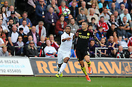 Wayne Routledge of Swansea city (l) holds off Aleksandar Kolarov of Manchester city (r). Premier league match, Swansea city v Manchester city at the Liberty Stadium in Swansea, South Wales on Saturday 24th September 2016.<br /> pic by Andrew Orchard, Andrew Orchard sports photography.
