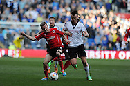 Cardiff city's Craig Noone (l) holds off Fulham's John Arne Riise (r). Barclays Premier league, Cardiff city v Fulham at the Cardiff city Stadium in Cardiff , South Wales on Sat 8th March 2014. pic by Andrew Orchard, Andrew Orchard sports photography