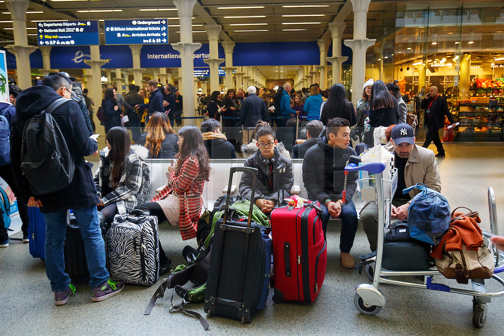 © Licensed to London News Pictures. 22/03/2016. London, UK. Passengers waiting for their cancelled trains and alternative travel options at London St Pancras Eurostar station as all Eurostar trains to Brussels have been cancelled the following the Brussels terror attacks on Tuesday, 22 March 2016. Photo credit: Tolga Akmen/LNP