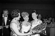 28/04/1965<br /> 04/28/1965<br /> 28 April 1965<br /> Festival of Kerry Dublin Ball at the Gresham Hotel, Dublin. Photo shows winner Miss Irene Courtney (right) receiving her award from Frances McDermott (centre) and Mrs Nanette Barrett, Chairman, Dublin Committee.