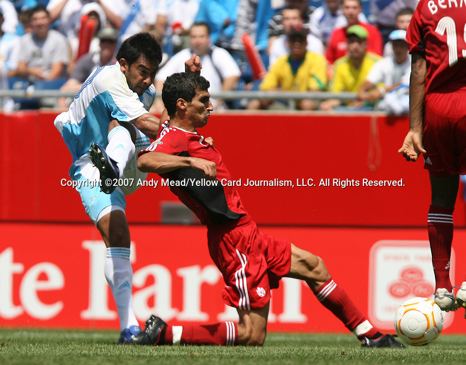16 June 2007: Guatemala's Carlos Ruiz (l) has a shot blocked by Canada's Paul Stalteri (r). The Canada Men's National team defeated the Guatemala Men's National Team 3-0 at Gillette Stadium in Foxboro, Massachusetts in a 2007 CONCACAF Gold Cup quarterfinal.