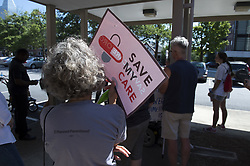July 29, 2017 - Atlanta, GA - Community organizers gather in Buckhead neighborhood to spread their message of preserving heath care for those with disabilities and other vulnerable populations, only days after a bill to repeal the Affordable Care Act died in the U.S. Senate. ''We need to be ready for the time when the issue comes back. It has not gone away,'' noted one of the demonstrators as traffic passed by a busy intersection.  Nationwide protests were organized by 'Our Lives on the Line. (Credit Image: © Robin Rayne Nelson via ZUMA Wire)