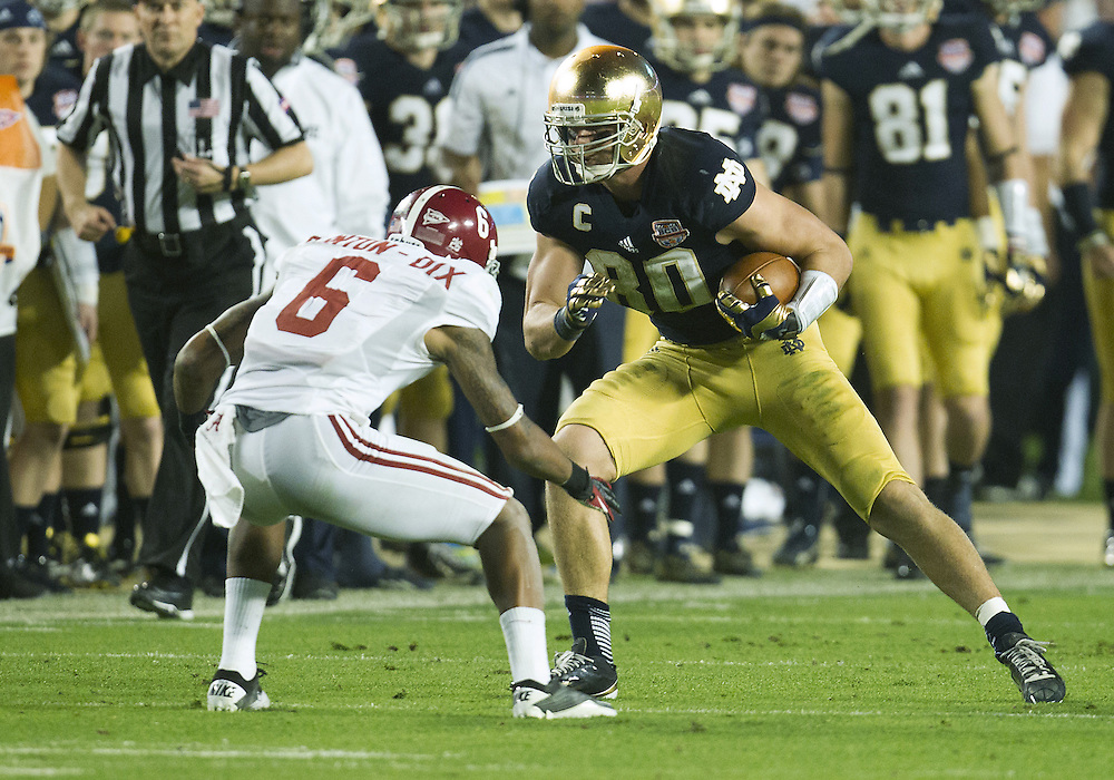 January 7, 2013:  Notre Dame tight end Tyler Eifert (80) runs for yardage after catch as Alabama defensive back Ha'Sean Clinton-Dix (6) attempts to make tackle during the Discover BCS National Championship between the Alabama Crimson Tide and the Notre Dame Fighting Irish at Sun Life Stadium in Miami Gardens, Florida.  Alabama defeated Notre Dame 42-14.