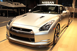 11 February 2009:2009 NISSAN GT-R: Nissan launched the new GT-R in the U.S.A. as an ?ultimate supercar for anyone, anywhere, at anytime.? Billed as a multi-dimensional performance machine, the GT-R?s newly developed midship package offers the world?s first application of an independent transaxle 4-wheel-drive system. Aerodynamic-shaped body combines steel, carbon fiber and aluminum panels for stiffness and lightness. Beneath the hood is the ?VR38,? a new 3.8-litre twin turbo V-6 engine that produces 470 horsepower. Depositing the 360 lb ft of torque to the ground is the 6-speed dual clutch transmission, with three modes: Normal (for maximum efficiency), Snow (for shifting on slippery surfaces), and R mode (for maximum performance with fastest shifts). Projected 0-to-60 miles per hour times is in the sub-4.0 second range. Large, 4-passenger cockpit contains sculpted performance bucket seats, a large center-mounted tachometer and specially designed Bose sound system.. The Chicago Auto Show is a charity event of the Chicago Automobile Trade Association (CATA) and is held annually at McCormick Place in Chicago Illinois.