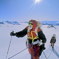 ANTARCTICA.  Norman Vaughan, 88, climbs steep ridge on first ascent of Mount Vaughan,  a 10,302-foot mountain, near the South Pole, that was named for him by Richard Byrd in honor of his participation in Byrd's 1929 expedition to fly over the Pole. Carolyn Muegge-Vaughan bkg.