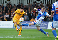 Newport goalscorer Andy Sandell (l) is tackled by David Clarkson of Bristol. Skybet League two match, Newport county v Bristol Rovers at Rodney Parade in Newport, South Wales on Saturday 17th August 2013. pic by Phil Rees ,Andrew Orchard sports photography,