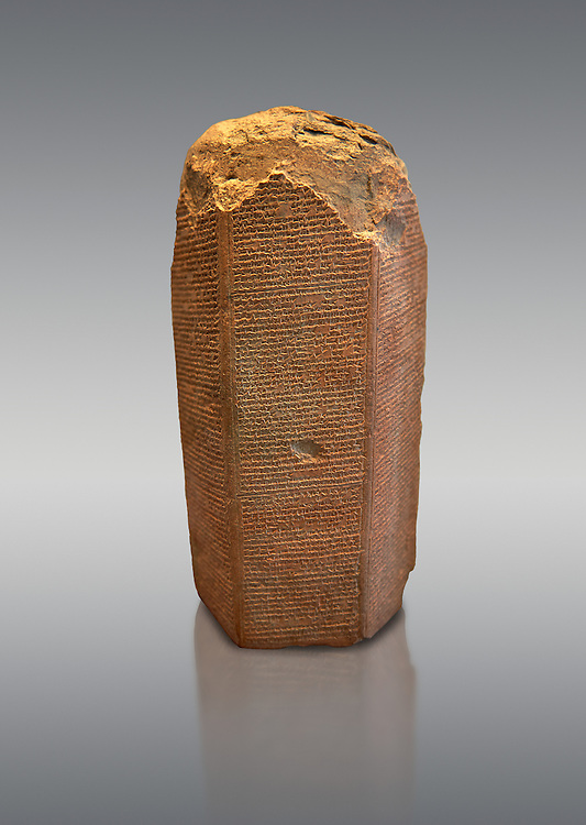 Stone hexagonal clay tablet with accounts of the Assyrian king Ashurnasirpal II  campaigns against Elam and the sacking of Susa. circa 645 BC. inv 19939  Louvre Museum , Paris .<br /> <br /> If you prefer to buy from our ALAMY PHOTO LIBRARY  Collection visit : https://www.alamy.com/portfolio/paul-williams-funkystock/ancient-assyria-antiquities.html  Refine search by adding background colour, place, subject, museum etc into the LOWER SEARCH WITHIN GALLERY box to <br /> <br /> Visit our ANCIENT ASSYRIAN PHOTO COLLECTIONS for more photos to download or buy as wall art prints https://funkystock.photoshelter.com/gallery-collection/Ancient-Assyrian-Art-Artefacts-Antiquities-Historic-Sites-Pictures-Images-of/C0000cjRqQyJjLag