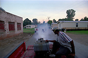 In rural Rosedale Mississippi the kids chase after the mosquito spray truck. The mayor Eddie Williams has allocated more of his budget to mosquito sparying, although they still use an old fog machine to spray. The machine produces a very thick heavy fog, that is safe for people.(photoSuzi Altman)
