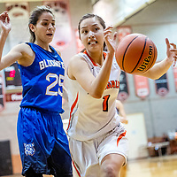 Bloomfield Bobcat Sierra Ortiz (25), looks on as the ball floats from the grasp of Gallup Bengal Ashley Antone (1) at Gallup High School Saturday.