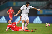 """Connor Roberts, left, of Wales national football team challenges Luis Suarez of Uruguay national football team in their final match during the 2018 Gree China Cup International Football Championship in Nanning city, south China's Guangxi Zhuang Autonomous Region, 26 March 2018.<br /> <br /> Edinson Cavani's goal in the second half helped Uruguay beat Wales to claim the title of the second edition of China Cup International Football Championship here on Monday (26 March 2018). """"It was a tough match. I'm very satisfied with the result and I think that we can even get better if we didn't suffer from jet lag or injuries. I think the result was very satisfactory,"""" said Uruguay coach Oscar Tabarez. Wales were buoyed by a 6-0 victory over China while Uruguay were fresh from a 2-0 win over the Czech Republic. Uruguay almost took a dream start just 3 minutes into the game as Luis Suarez's shot on Nahitan Nandez cross smacked the upright. Uruguay were dealt a blow on 8 minutes when Jose Gimenez was injured in a challenge and was replaced by Sebastian Coates. Inter Milan's midfielder Matias Vecino of Uruguay also fired at the edge of box from a looped pass but only saw his attempt whistle past the post. Suarez squandered a golden opportunity on 32 minutes when Ashley Williams's wayward backpass sent him clear, but the Barca hitman rattled the woodwork again with goalkeeper Wayne Hennessey well beaten."""