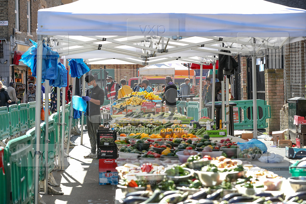 "General view of ""East Street Market"" in Walworth, South London, where people are seen using mostly vouchers to buy groceries on Tuesday, May 5, 2020.<br /> Under a government scheme, families in need in England should receive vouchers worth £15 a week per child. Whilst a few European countries relax the COVID-19 lockdown, Britain still remains under lockdown without an exit strategy yet. (Photo/Vudi Xhymshiti)"