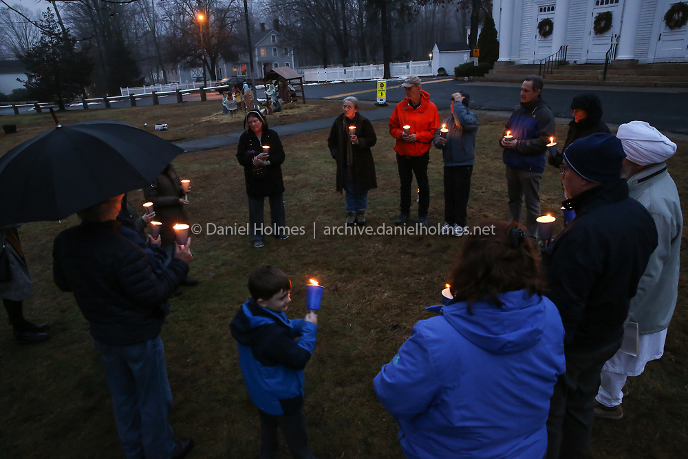 (12/14/19, HOLLISTON, MA) People gather with candles during a candlelight vigil to remember victims of gun violence on the anniversary of the Sandy Hook Elementary School shooting at the First Congregational Church of Holliston on Saturday. [Daily News and Wicked Local Photo/Dan Holmes]