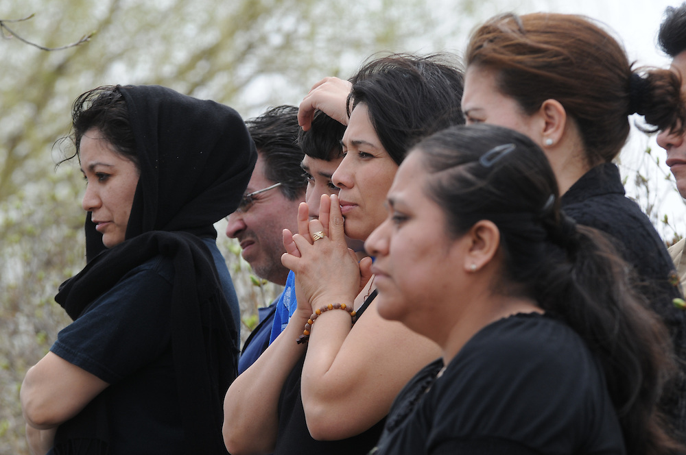 Catholic faithful are gathered around the parking lot of Most Blessed Trinity Parish in Waukegan during a mass attended by Francis Cardinal George following a Living Way of the Cross procession.