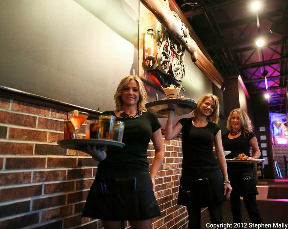 Bartender/Server Andrea Carnes (from left), Server Nicole Page, and Server Stephanie Mulligan hold trays of drinks and food at Zeppelins Bar & Grill, 5300 Edgewood Road NE, in Cedar Rapids on Monday, August 6, 2012.