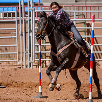Jenesis Trujeque weaves through the poles during the Jr High School Finals rodeo Friday at Red Rock Park in Gallup.