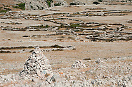 Cairns and mrgari (ancient stone-walled sheep pens). Hiking trail on Hlam and the so-called Plato Mjeseca ('lunar plateau'), near Baska, on the island of Krk, Croatia