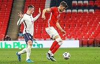 LONDON, ENGLAND - MARCH 31: Phil Foden of England competes with Jakub Moder of Poland during the FIFA World Cup 2022 Qatar qualifying match between England and Poland on March 31, 2021 in London, United Kingdom. Sporting stadiums around the UK remain under strict restrictions due to the Coronavirus Pandemic as Government social distancing laws prohibit fans inside venues resulting in games being played behind closed doors. (Photo by Wlosek/PressFocus/MB Media)