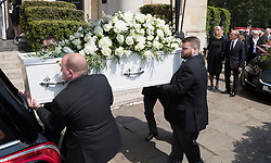 © Licensed to London News Pictures. 22/05/2018. London, UK. Family and friends of television presenter Dale Winton (R) look on as his coffin is carried into Commonwealth Church in Marylebone, London. Dale Winton, who was found dead at his home on April 18, was famous for presenting Supermarket Sweep and National Lottery game show. Photo credit: Peter Macdiarmid/LNP