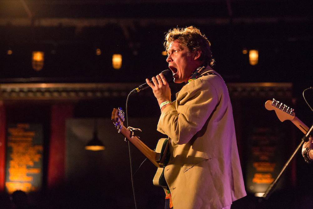 Alex Battles on stage.