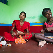 CAPTION: Ningarajamma is a flower vendor. Thanks to the Chamkol programme's Revolving Fund Scheme, she has been able to invest in this business and in turn make it easier for her family to support her brother Jawara Naik, who has a severe learning disability. LOCATION: Alduru (village), Santhemarahalli (hobli), Chamrajnagar (district), Karnataka (state), India. INDIVIDUAL(S) PHOTOGRAPHED: Ningarajamma (left) and Jawara Naik (right).