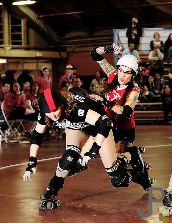 OKC Victory Dolls roller derby match against the Arkansas River City Roller Girls