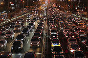 BEIJING, CHINA - SEPTEMBER 28: (CHINA OUT)<br /> <br /> Vehicles stuck on the main roads near Guomao Bridge on September 28, 2014 in Beijing, China. Beijing releases driving restriction on a workday adjusted from a Sunday due to the upcoming holiday of National Day on October 1st<br /> ©Exclusivepix