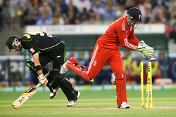 © Licensed to London News Pictures. 26/12/2013. Jos Buttler breaks the stumps in an attempt to run out Glenn Maxwell during the 2nd T20 international between Australia Vs England at the Melbourne Cricket Ground, Victoria, Australia. Photo credit : Asanka Brendon Ratnayake/LNP