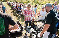 """Local Eatery Chef Kevin Halligan serves Amber Gagnon a ham, cheddar and apple omelet during Sunday morning's Breakfast at the Orchard"""" held in Smith's Apple Orchard in Belmont.    (Karen Bobotas/for the Laconia Daily Sun)"""