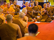 02 APRIL 2015 - CHIANG MAI, CHIANG MAI, THAILAND:  Buddhist monks pray in Wat Chedi Luang in Chiang Mai during a prayer service to mark the 60th Birthday celebrations for HRH Princess Maha Chakri Sirindhorn, daughter of Bhumibol Adulyadej, the King of Thailand, and his wife, Queen Sirikit. The Princess is revered by most Thais and her birthday is celebrated throughout Thailand.   PHOTO BY JACK KURTZ