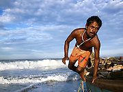 Fisherman at work with their last catch before the monsoon rains arrive, Odayam Beach, Kerala, India
