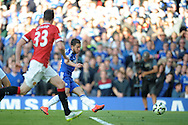 Eden Hazard of Chelsea shoots and scores his sides first goal of the game to make it 1-0. Barclays Premier league match, Chelsea v Manchester Utd at Stamford Bridge Stadium in London on Saturday 18th April 2015.<br /> pic by John Patrick Fletcher, Andrew Orchard sports photography.