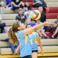 Dulce Hawk Caitlin Duncan (15) reverse volleys to the Rehoboth Lynx at Rehoboth High School Saturday.