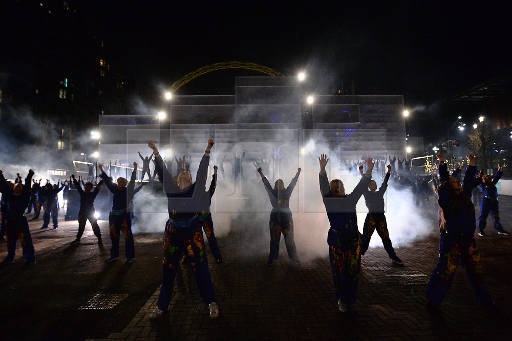 © Licensed to London News Pictures. 18/01/2020. London, UK. Performers take part in the RISE celebrating Brent as London's Borough of Culture 2020. The show took place in front of Wembley Stadium and bought together theatre, dance and music to tell the story of Brent through a mass-participatory performance choreographed by Southpaw Dance Company. Photo credit: Ray Tang/LNP