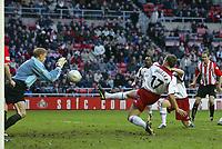 Photo. Andrew Unwin.<br /> Sunderland v Sheffield United, FA Cup Sixth Round, Stadium of Light, Sunderland 07/03/2004.<br /> Sheffield United's Phil Jagielka (r) fires his shot straight at Sunderland's Mart Poom (l).