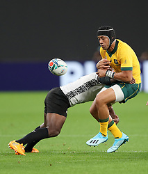 Australia's Christian Lealiifano is tackled by Fiji's Levani Botia during the 2019 Rugby World Cup Pool D match at Sapporo Dome.