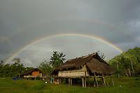 Kwerba Village houses with rainbow.