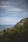 Cape Silleiro Lighthouse on the hillside looking at Atlantic Ocean, Galicia, Spain Ⓒ Davis Ulands   davisulands.com