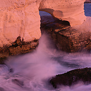 Elephant's Foot, a natural arch cut into the soft limestone by the relentless pounding of the Mediterranean surf.