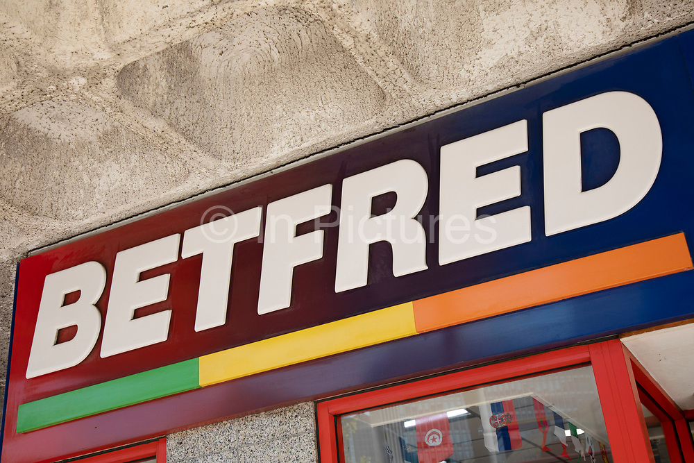 Sign for the gambling brand Betfred in Birmingham, United Kingdom.