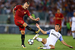 August 26, 2017 - Rome, Italy - Ivan Perisic of Internazionale tackling on Radja Nainggolan of Roma at Olimpico Stadium in Rome, Italy on August 26, 2017during the Serie A match between AS Roma and FC Internazionale on August 26, 2017 in Rome, Italy. (Credit Image: © Matteo Ciambelli/NurPhoto via ZUMA Press)