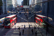 An aerial cityscape of Londoners, general traffic and a London bus on Upper Thames Street (west of London Bridge) in the City of London - the capital's financial district, on 10th October 2018, in London, England.