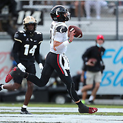 ORLANDO, FL - NOVEMBER 21:  Desmond Ridder #9 of the Cincinnati Bearcats runs the ball in for a touchdown against the Central Florida Knights at Bounce House-FBC Mortgage Field on November 21, 2020 in Orlando, Florida. (Photo by Alex Menendez/Getty Images) *** Local Caption *** Desmond Ridder