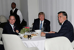 U.S. President-elect Donald Trump sits at a table with Former Governor of Massachusetts Mitt Romney and Reince Priebus (L) at Jean Georges Restaurant on November 29, 2016 in New York City. U.S. President-elect Donald Trump spent the afternoon holding meetings at Trump Tower as he continues to fill in key positions in his new administration. Photo by John Angelillo/UPI