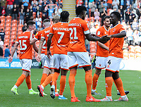 Blackpool's Armand Gnanduillet celebrates scoring his side's second goal with teammates Rocky Bushiri, Nathan Delfouneso<br /> <br /> Photographer Alex Dodd/CameraSport<br /> <br /> The EFL Sky Bet League One - Blackpool v Oxford United - Saturday 17th August 2019  - Bloomfield Road - Blackpool<br /> <br /> World Copyright © 2019 CameraSport. All rights reserved. 43 Linden Ave. Countesthorpe. Leicester. England. LE8 5PG - Tel: +44 (0) 116 277 4147 - admin@camerasport.com - www.camerasport.com