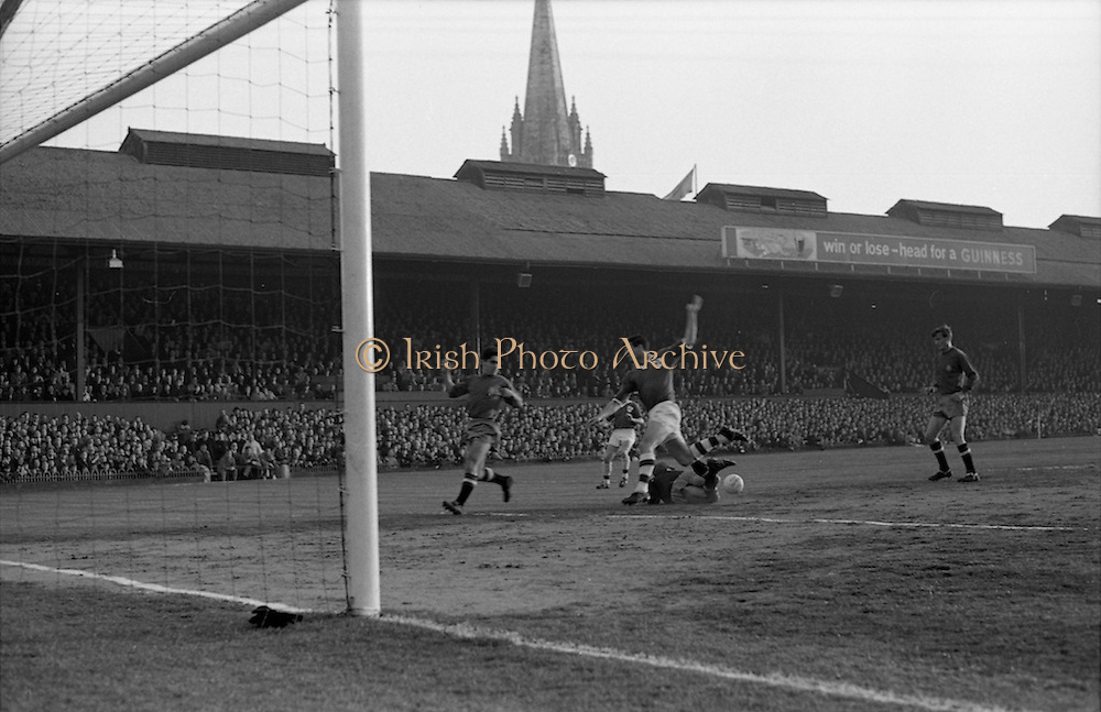 05/05/1965<br /> 05/05/1965<br /> 05 May 1965<br /> Ireland v Spain, World Cup Qualifier at Dalymount Park, Dublin. Jose Iribar goes down to foil an Irish attack by Noel Cantwell? Ireland won the game 1-0.