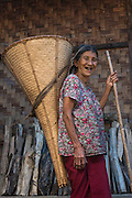 Ao Naga carrying rice basket<br /> Ao Naga headhuntingTribe<br /> Mokokchung district<br /> Nagaland,  ne India
