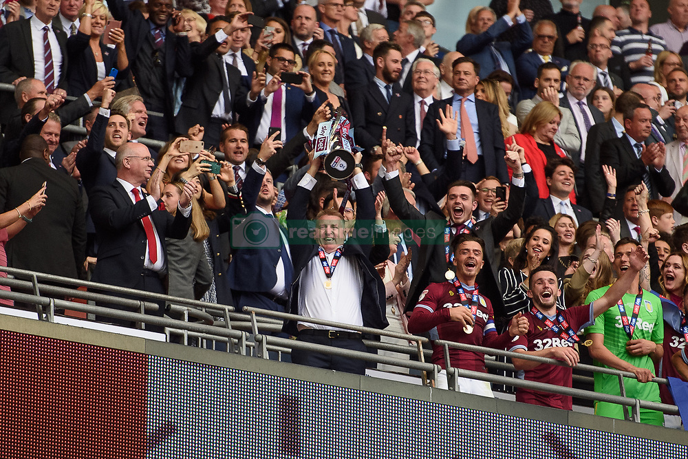 May 27, 2019 - London, England, United Kingdom - Aston Villa Manager Dean Smith holds the winners trophy during the Sky Bet Championship match between Aston Villa and Derby County at Wembley Stadium, London on Monday 27th May 2019. (Credit: Jon Hobley | MI News) (Credit Image: © Mi News/NurPhoto via ZUMA Press)