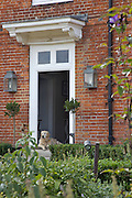 The family dog, Bracken, keeping watch at the front door on Hares Farm CREDIT: Vanessa Berberian for The Wall Street Journal<br /> UKFARM-Hares Farm